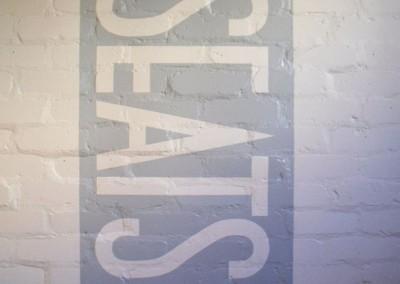 Hand painted lettering onto interior brickwork