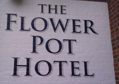 Hand painted lettering onto exterior brickwork
