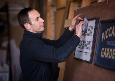 Signwriter with his sign