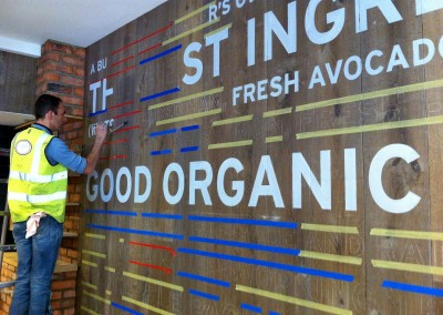 Signwriting a wall at Pret A Manger