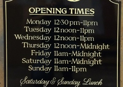 Handpainted pub opening times sign