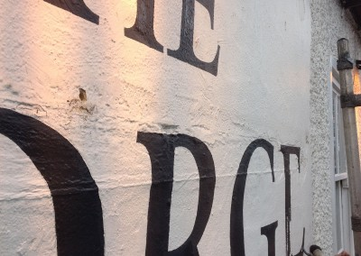 Pub wall lettering