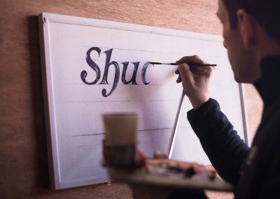 Signwriter at work
