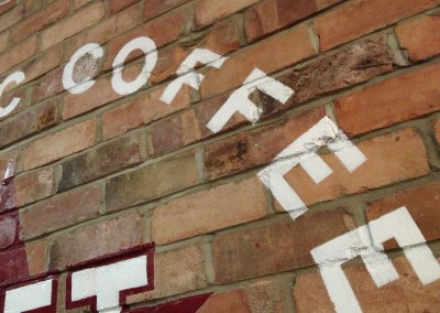 Hand painted lettering onto interior brickwork