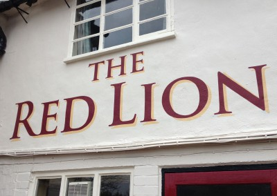 The Red Lion pub wall sign